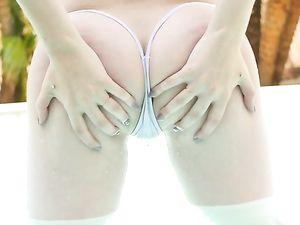 Babe In A G-String Bikini Strokes His Cock Poolside
