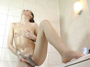 Showering Beauty With A Bush Fucks A Big Dildo