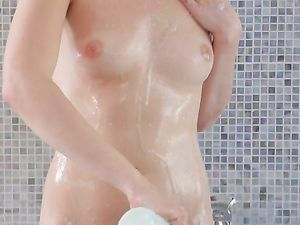 Bathing Cutie Blows Her Man And Takes Dick Balls Deep